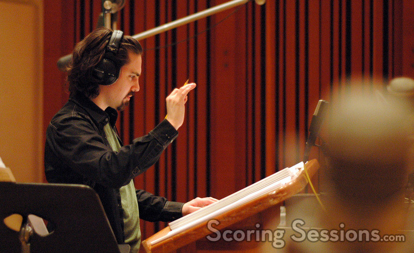 Bear McCreary conducts