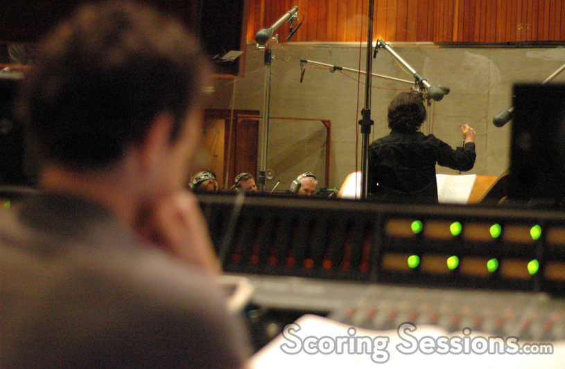 Steve Kaplan watches as Bear McCreary conducts the strings