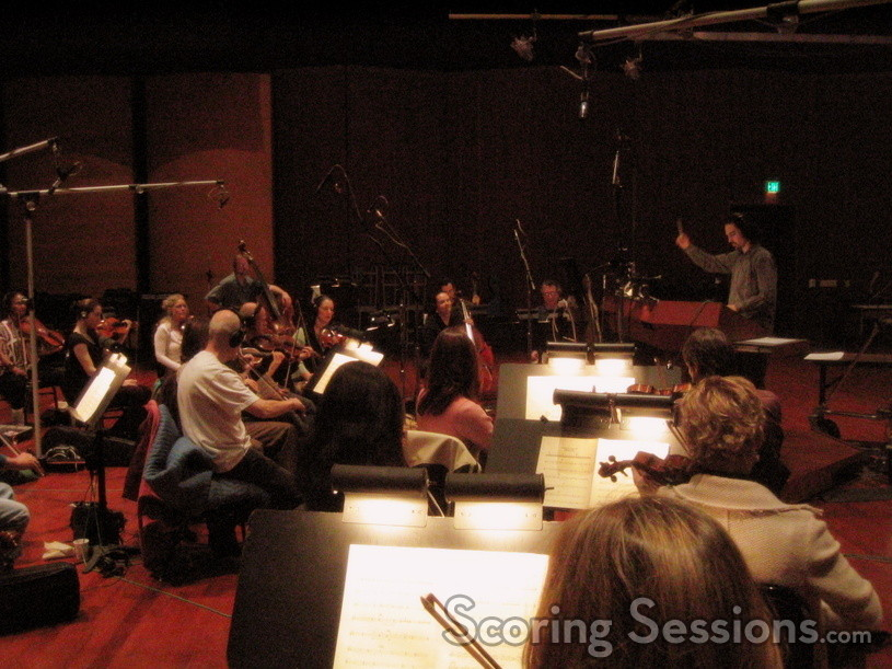 Bear McCreary conducts a string session at the Warner Brothers Stage