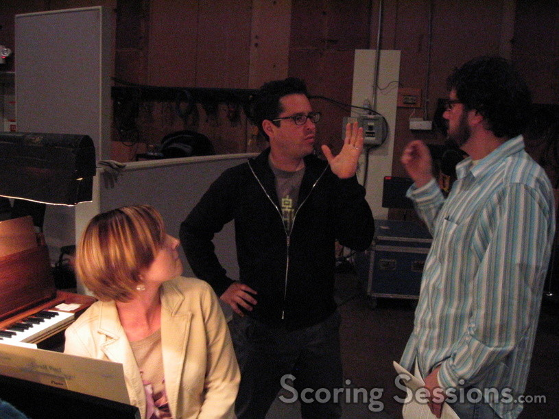 Music copyist Jennifer Hammond listens to director JJ Abrams and composer Michael Giacchino discussing the score