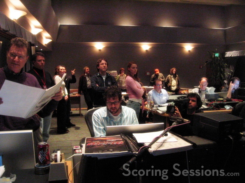 Alias star Jennifer Garner visits the scoring session (talking with J.J. Abrams) as score preparers Chad Seiter and Andrea Datzman observe Michael Giacchino giving feedback on a cue