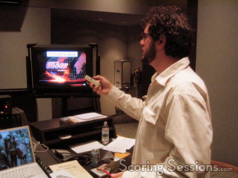 Michael Giacchino gives Tim Simonec feedback on a take