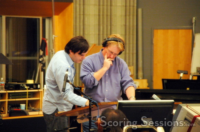 Composer Marcelo Zarvos and conductor Pete Anthony examine the score to <i>The Air I Breathe </i>