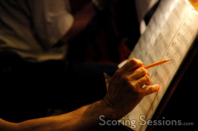 A cellist notes a change to the score