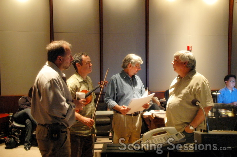 Steve Erdody, Roger Wilkie, and Mike Nowak confer with orchestrator Dave Metzger