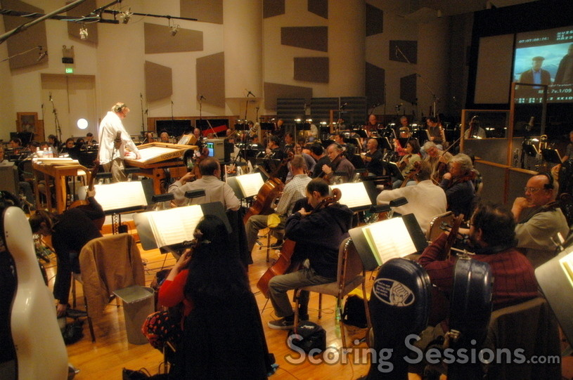 Don Harper rehearses a cue with the orchestra