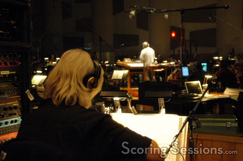 Guitarist George Doering performs in an iso-booth as the orchestra performs the score
