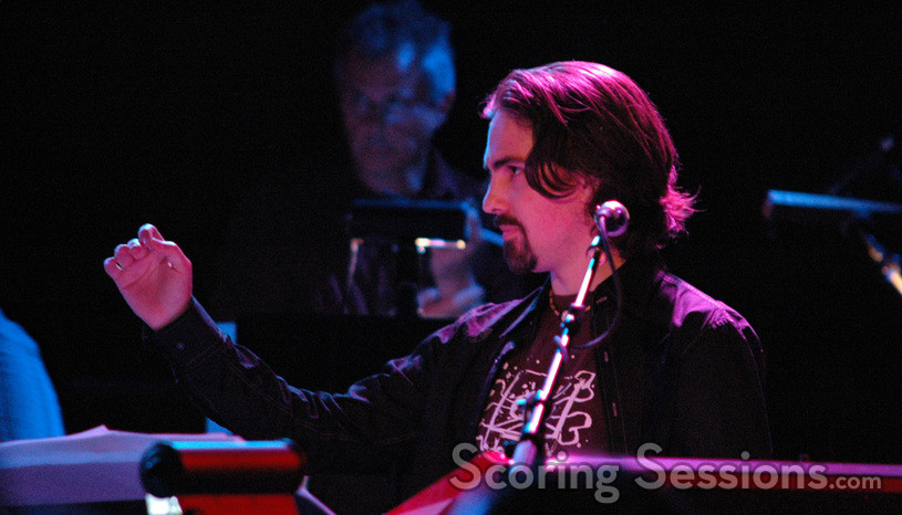 Bear McCreary conducts during Lords of Kobol.