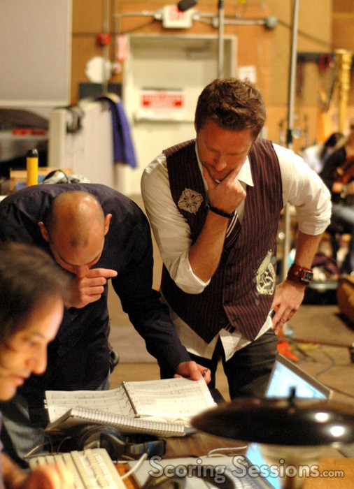Orchestrator Robert Elhai, music editor Joe Lisanti and composer Brian Tyler examine the score