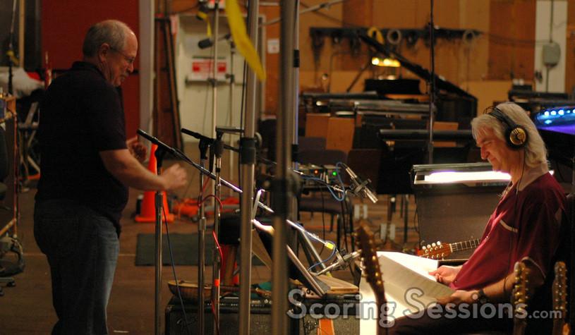 Dennis Sands sets up a microphone for guitarist George Doering