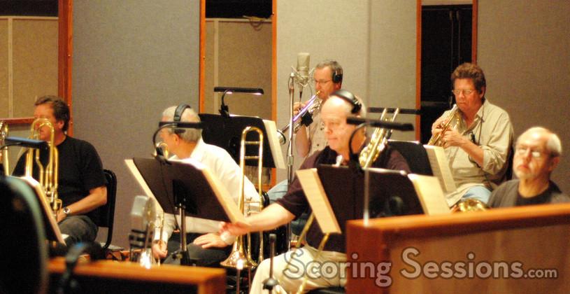 Trumpets: Jon Lewis & Wayne Bergeron.  Middle trombone: Bill Booth; Bass trombone: Bob Sanders; on his right tubist Jim Self