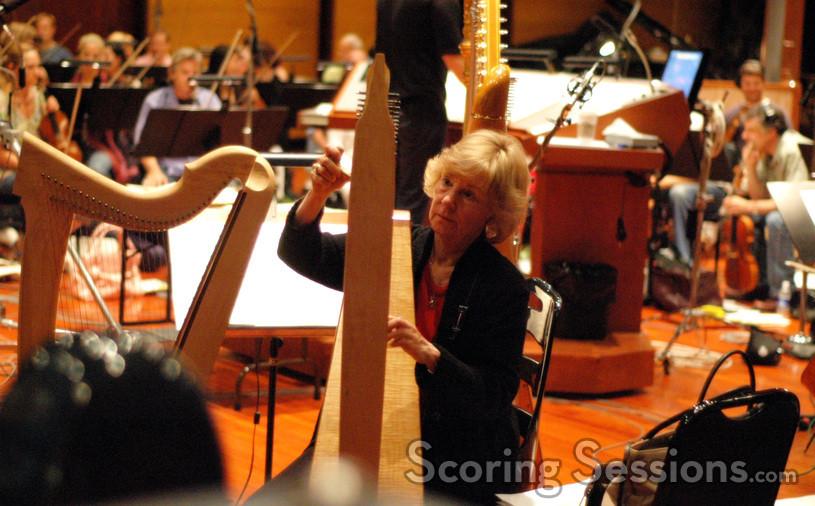 Gayle Levant tunes her harp