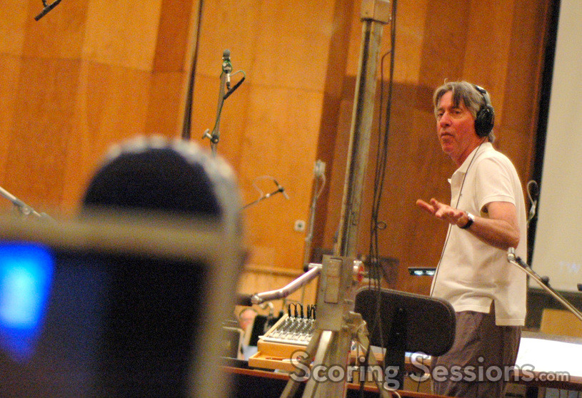 Alan Silvestri gives feedback to the orchestra