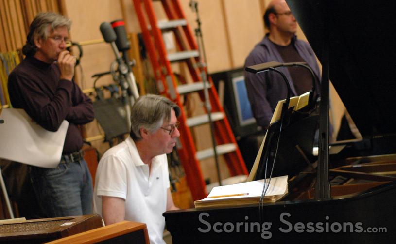 Music librarian Mark Graham watches as Alan Silvestri reworks a cue