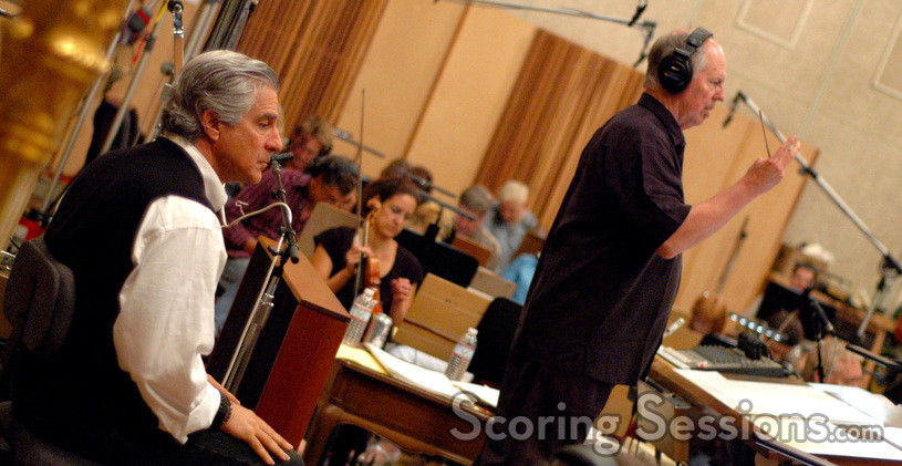 George S. Clinton conducts the Hollywood Studio Symphony as director Michael Lembeck watches