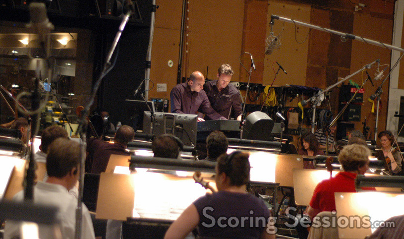 Music editor Joe Lisanti and composer Brian Tyler examine the score