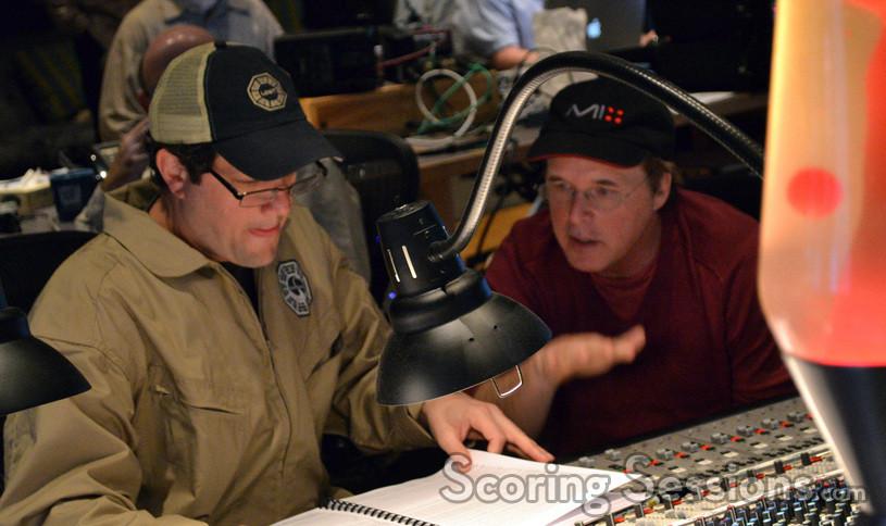 Composer Michael Giacchino and director Brad Bird examine a cue