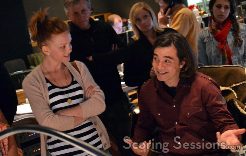 Actress Jayma Mays listens as composer Heitor Pereira discusses the score to <i>The Smurfs</i>