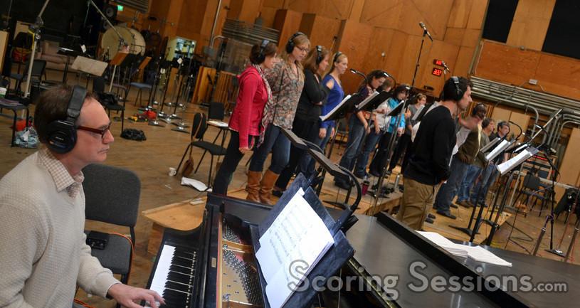 Marshall Bowen assists the choir
