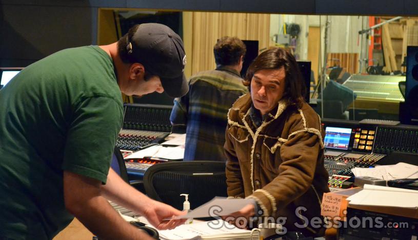 Music editor Ben Schor and composer Heitor Pereira examine a cue