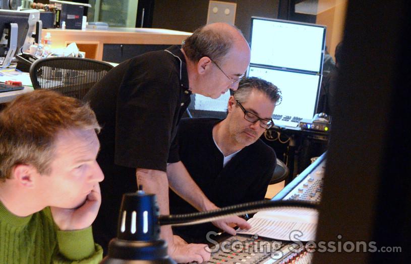 Additional music composer Marcus Trumpp awaits as scoring mixer John Kurlander and composer Marco Beltrami discuss a cue