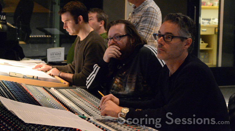 Additional music composers Brandon Roberts and Marcus Trumpp (rear), director John Moore, composer Marco Beltrami