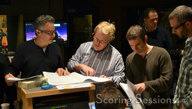 Composer Marco Beltrami, conductor Pete Anthony, and additional music composer Brandon Roberts make edits to a cue