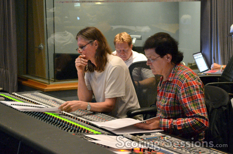 Scoring mixer Paul Linford and composer Trevor Rabin listen back to a cue