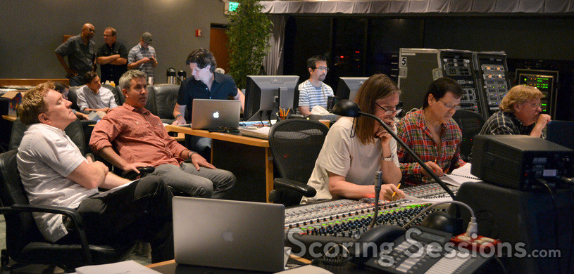 The control booth listens to a cue: producer Michael Ewing, director Peter Segal, music editor Robbie Boyd, ProTools recordist Larry Mah, scoring mixer Paul Linford, composer Trevor Rabin, and orchestra mixer Steve Kempster
