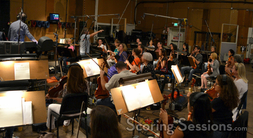 Concertmaster Bruce Dukov talks to the violin section