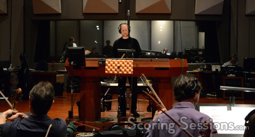 Composer Rolfe Kent conducts his score for <i>Labor Day</i>