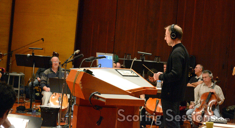 Composer Rolfe Kent conducts the orchestra