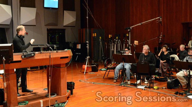 Composer Rolfe Kent gives feedback to the violins