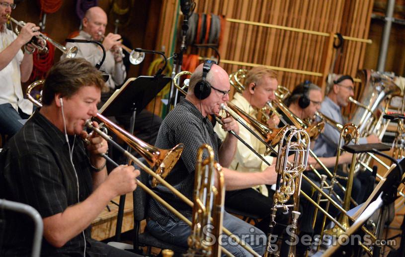The brass: trumpets Jon Lewis & Rob Frear, trombonists Steve Holtman, Alex Iles, Phil Keen, Bill Reichenach, and tubist Doug Tornquist