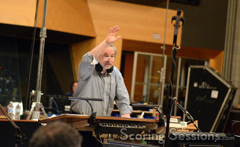 Composer Nicholas Dodd gives feedback to the orchestra