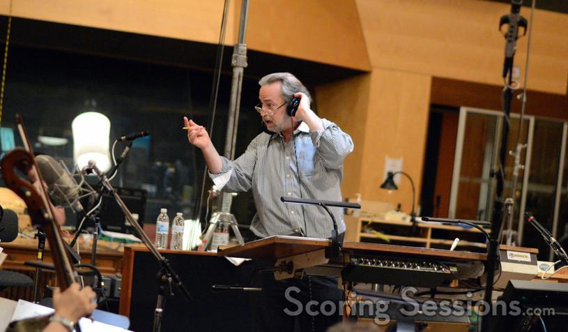 Conductor Nicholas Dodd talks to the orchestra