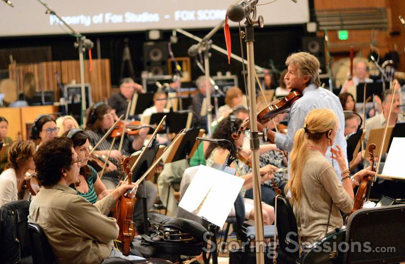 Concertmaster Bruce Dukov speaks to the violins