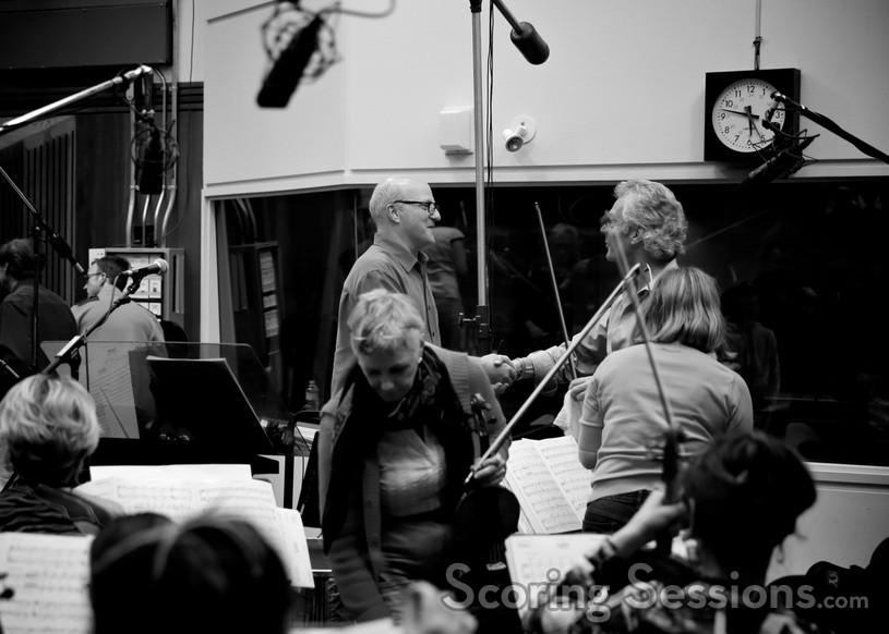 Engineer Brad Haehnel talks with concertmaster Victor Costanzi