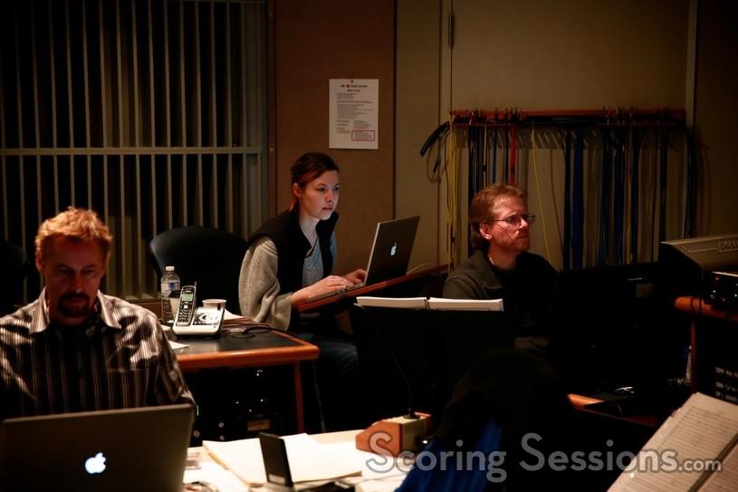 orchestrator Greg Prechel, music editor Meagan Carsience, and score recordist Vince Renaud