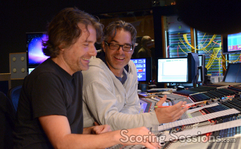 Additional music composer Buck Sanders shares a light moment with composer Marco Beltrami