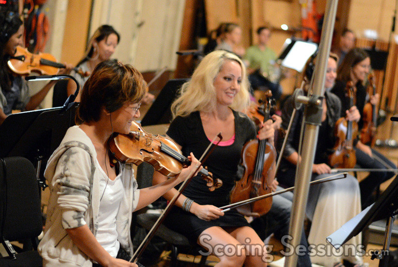 The violins enjoy composer Henry Jackman's score