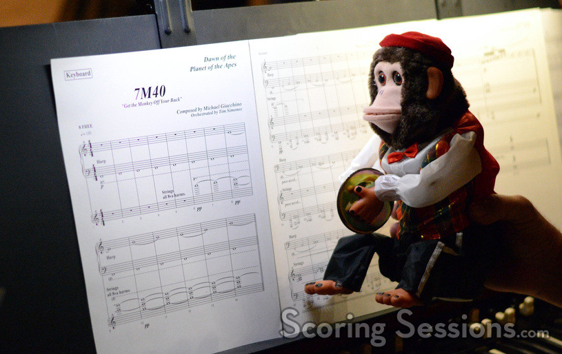 A monkey looks at the keyboard part for the cue Get the Monkey Off Your Back from <i>Dawn of the Planet of the Apes</i>