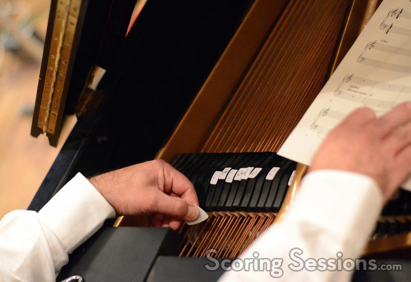 Pianist Mark Gasbarro plucks the piano strings