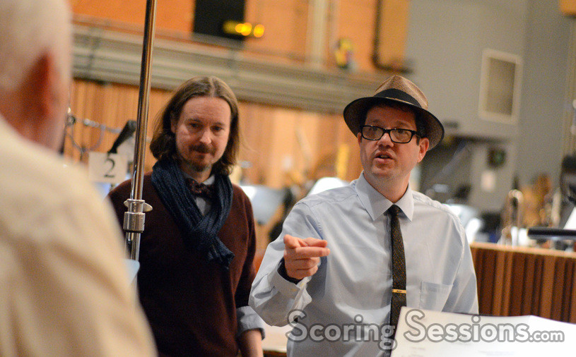 Composer Michael Giacchino and director Matt Reeves give directions to percussionist Dan Greco