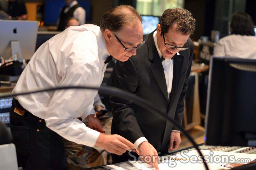 Music librarian Marshall Bowen goes over a cue with composer Michael Giacchino