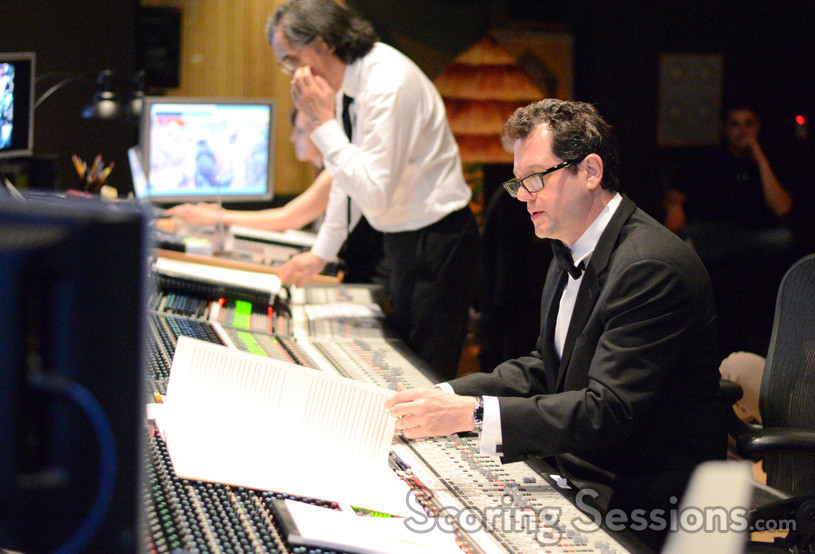 Score coordinator Andrea Datzman, scoring mixer Joel Iwataki, and composer Michael Giacchino go over a cue