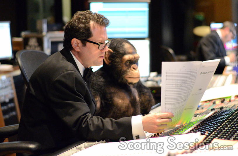 Composer Michael Giacchino goes over a cue with Caesar