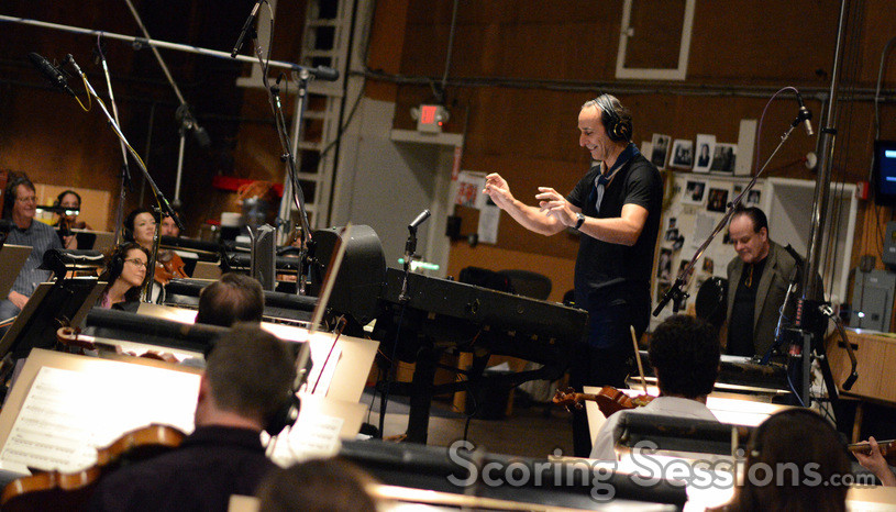 Composer and conductor Alexandre Desplat is pleased by the orchestra's performance