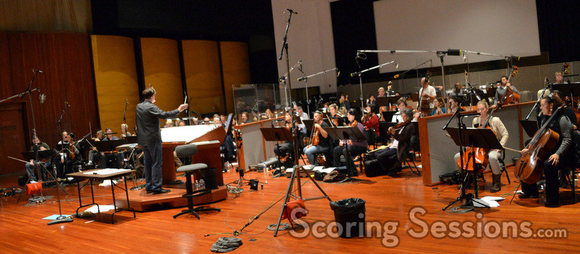 Composer Timothy Williams conducts the orchestra