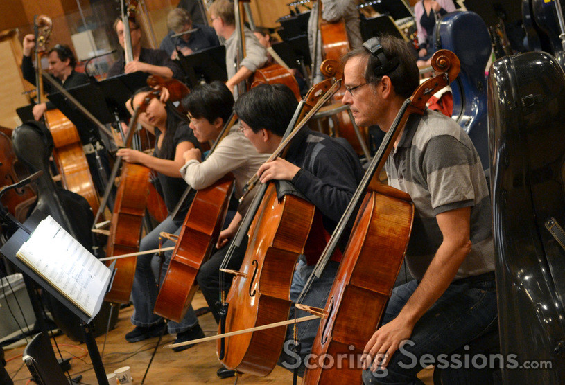 The cello section waits patiently for the next take